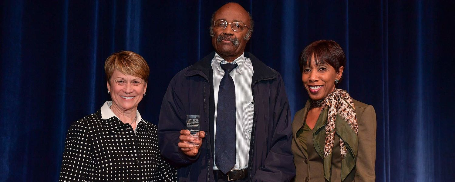 Kent State President Beverly J. Warren and Vice President for Diversity, Equity and Inclusion Afreda Brown stand with David Duncan, widower of Rozell Duncan, Ph.D. The Student Diversity Award is now named after his late wife.
