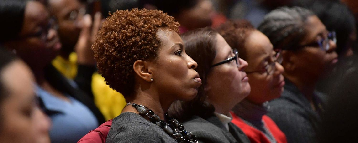 Audience members listen to Angela Rye give the keynote speech at the university's annual Martin Luther King Jr. Celebration in the Kent Student Center Ballroom.
