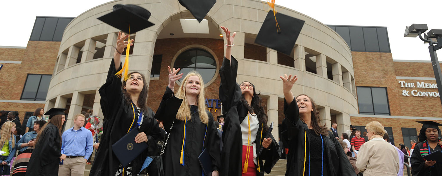 Students celebrate after the Saturday morning commencement