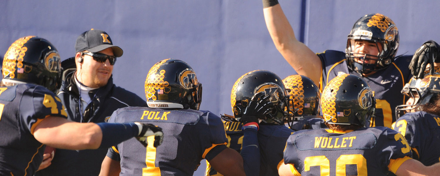 Members of the Kent State Golden Flashes celebrate a touchdown against Ohio University during the final home game at Dix Stadium.
