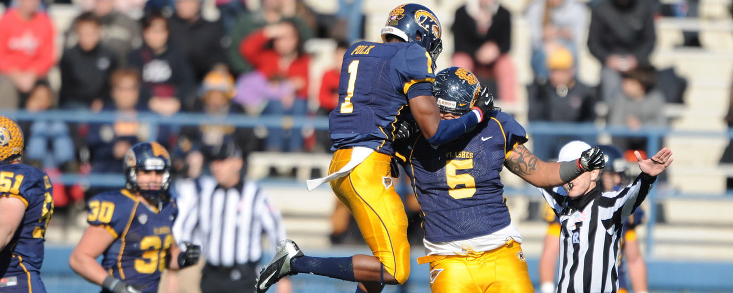 Kent State Golden Flashes Darius Polk and Roosevelt Nix celebrate a touchdown against Ohio University during the final home game this season.
