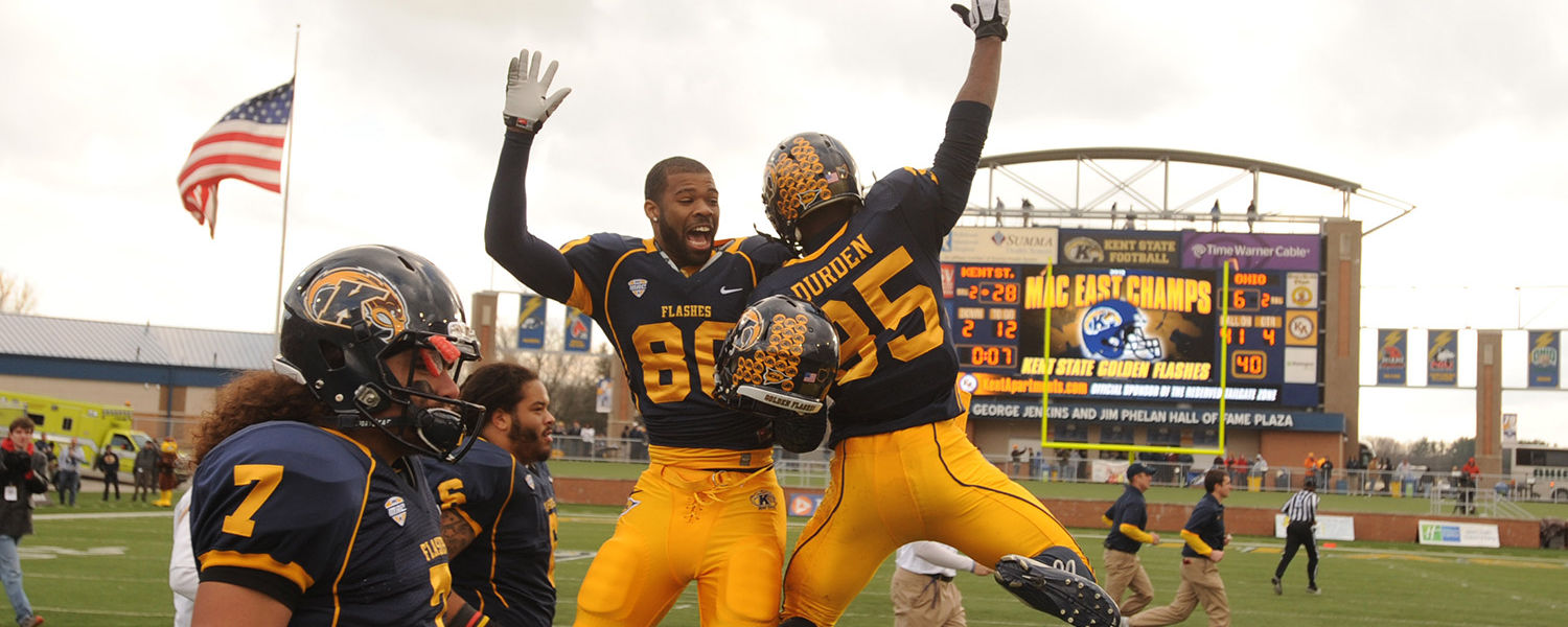 Golden Flashes players Charles Chandler and Julian Durden celebrate Kent's victory over Ohio during the final home game. The Flashes won all of their MAC games this year and are headed to the league championship game.