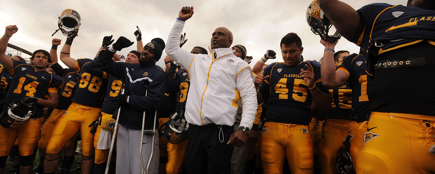 Coach Hazell and the Golden Flashes sing the KSU fight song after the football team's victory over Ohio University.
