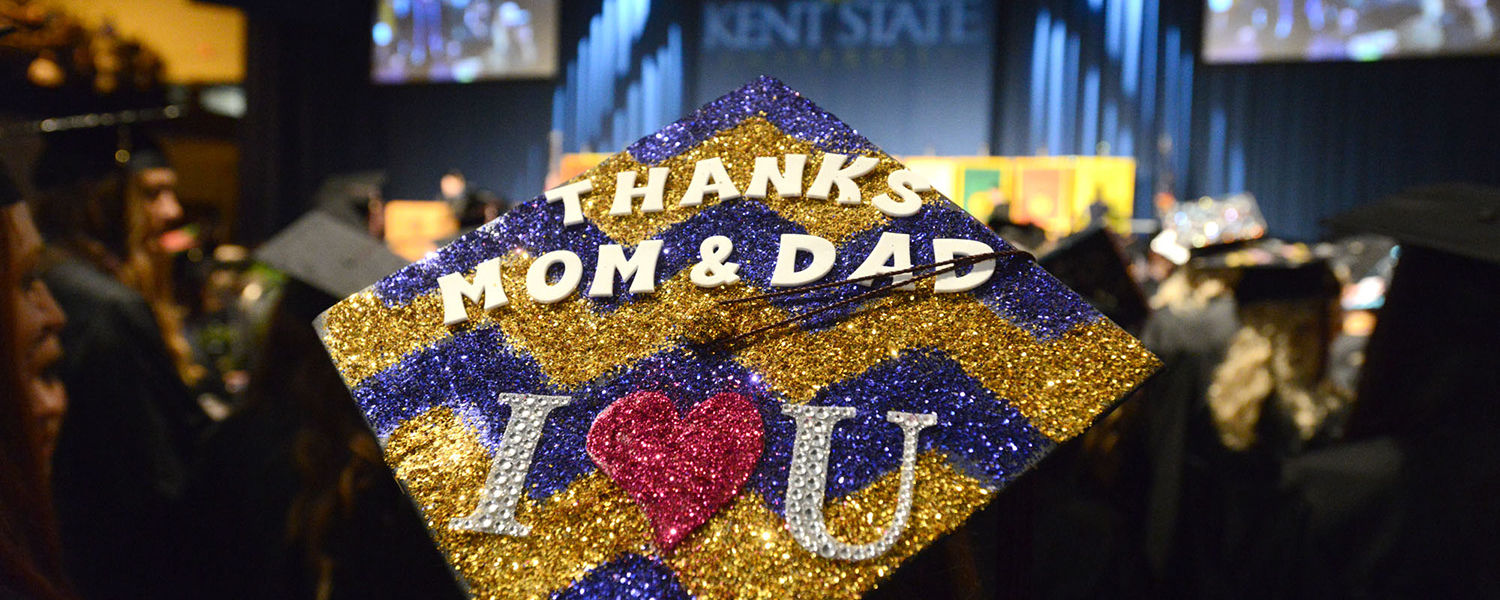 A graduate's hat displays a note to her parents at the Saturday morning commencement