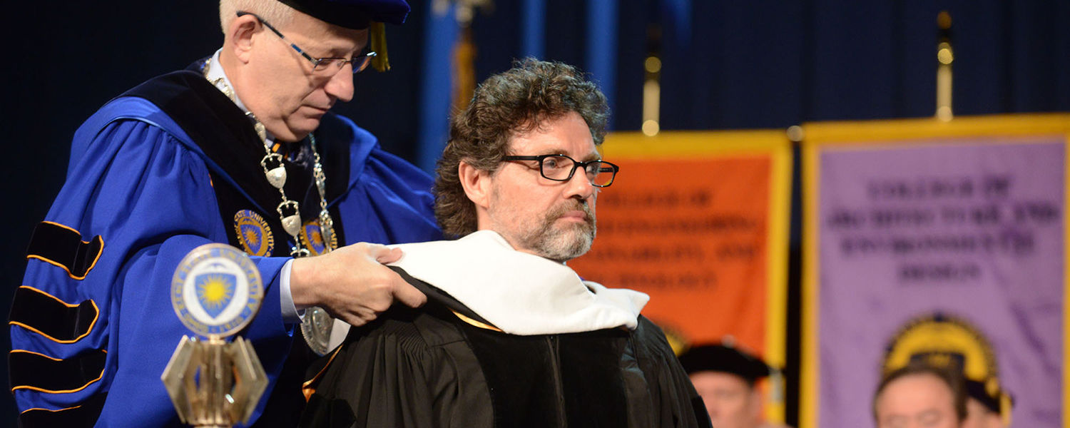 Dr. Lefton hoods Kent State Alum Jeff Richmond during the Saturday morning  commencement, giving Richmond an Honorary PhD
