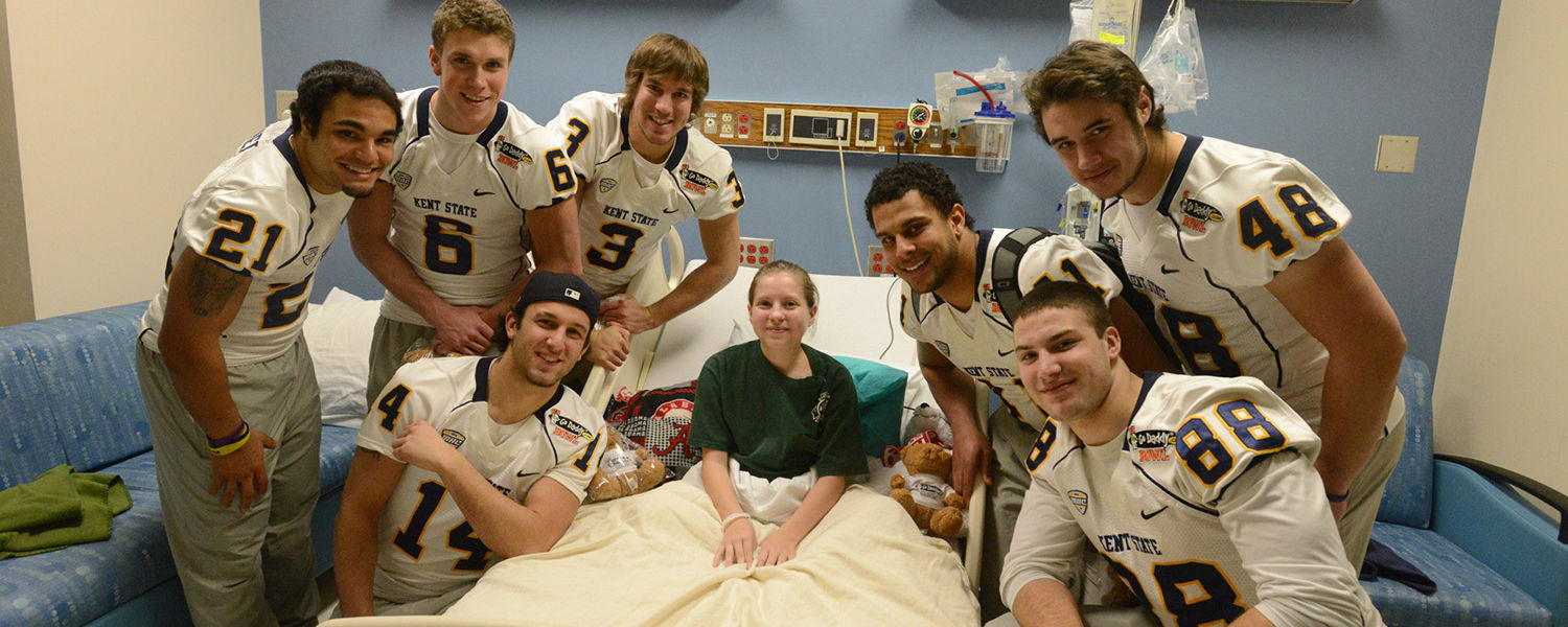 Members of the Kent State football team visit with hospital patient Amber Mozingo at the Children and Women's Hospital in Mobile, Alabama.