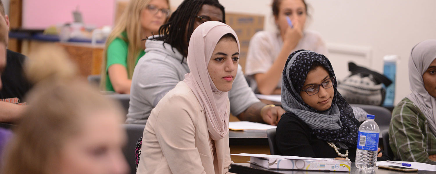 Kent State students listen to a lecture in a classroom in White Hall.