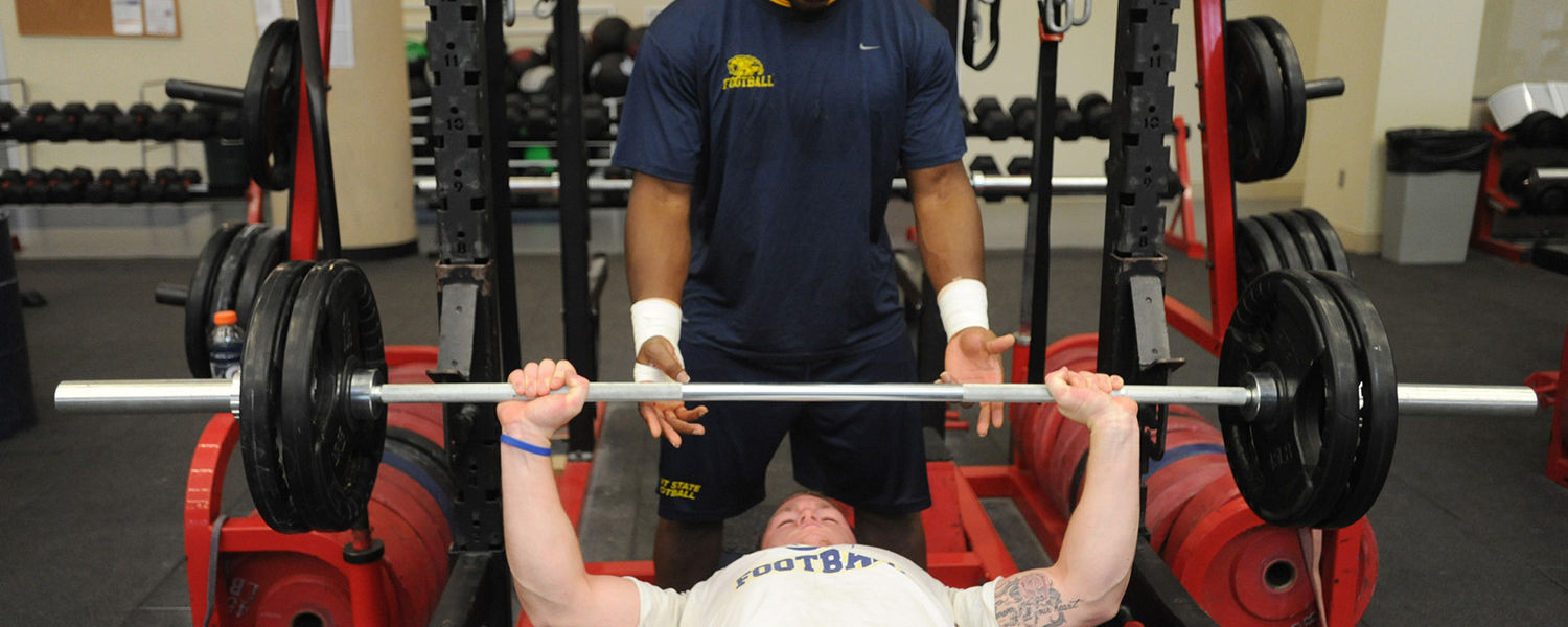 Team members work out in the weight room at the University of Southern Alabama.