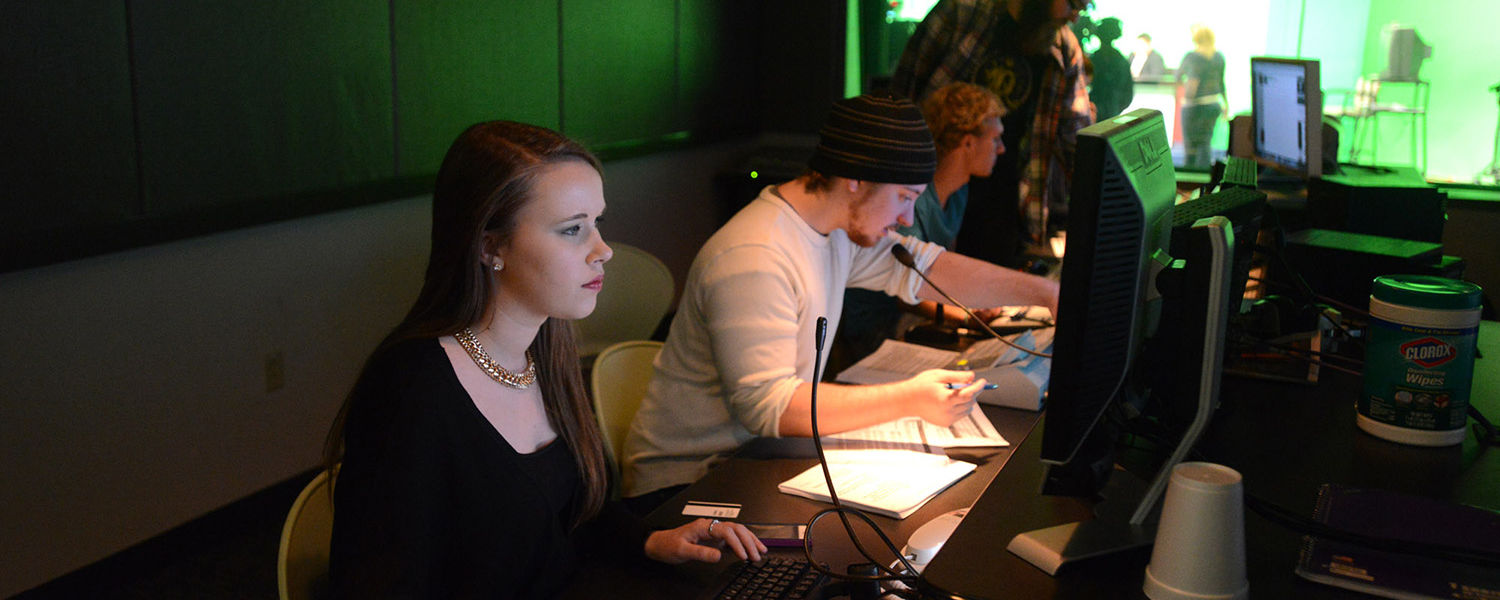 In a control room just outside the studio, a team of Kent State students direct and produce the newscast, working to keep everything running smoothly.