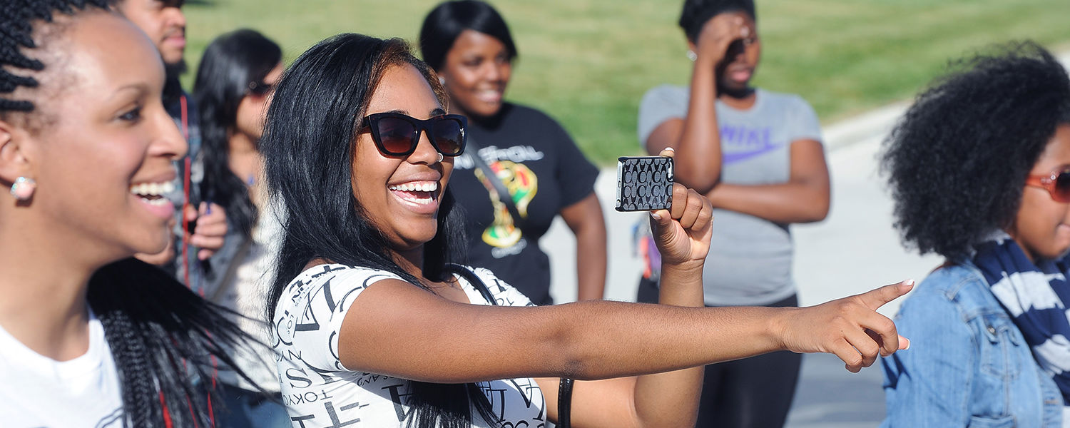 Kent State students enjoy musical performances on the stage of the Student Green during the annual Black Squirrel Festival.