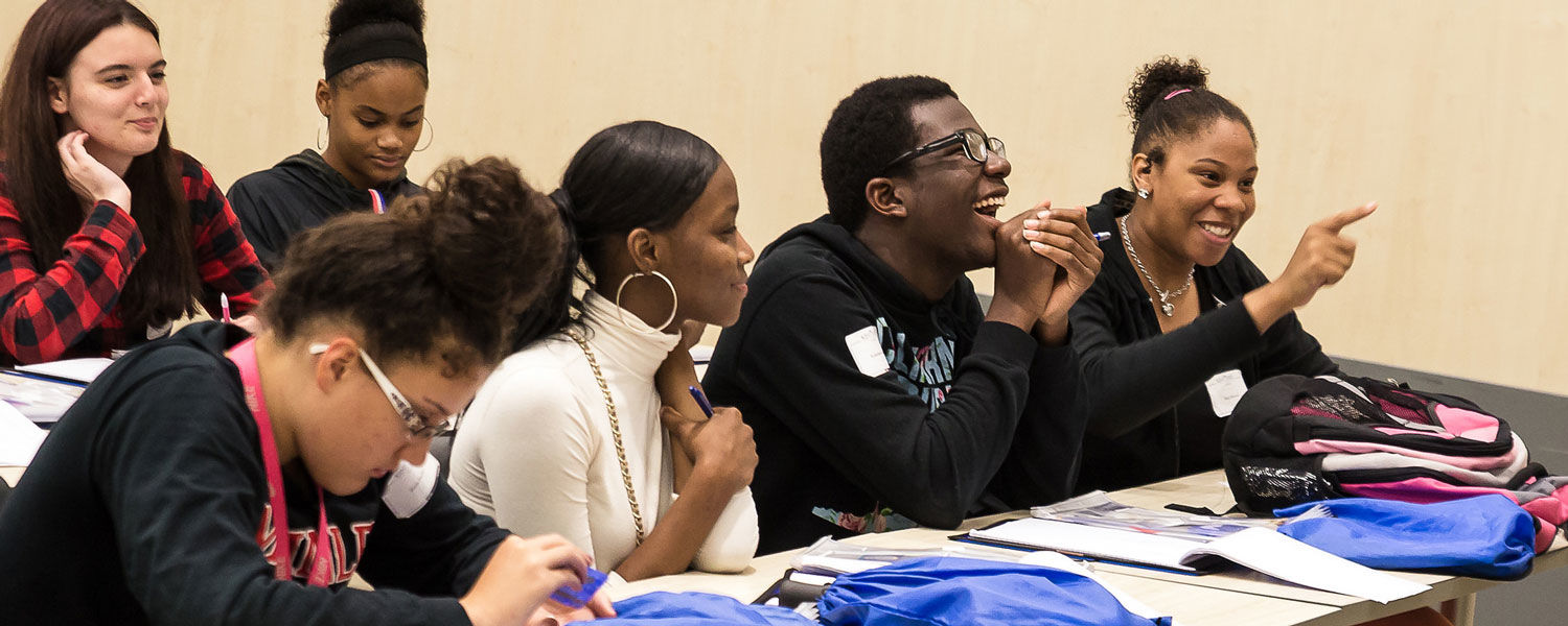 Jada Howard (far right) makes a point during a lively discussion on how to develop good critical thinking skills during the Bulldog Flash Academic Institute. The 14-year-old Canton McKinley High School student dreams of becoming a veterinarian.