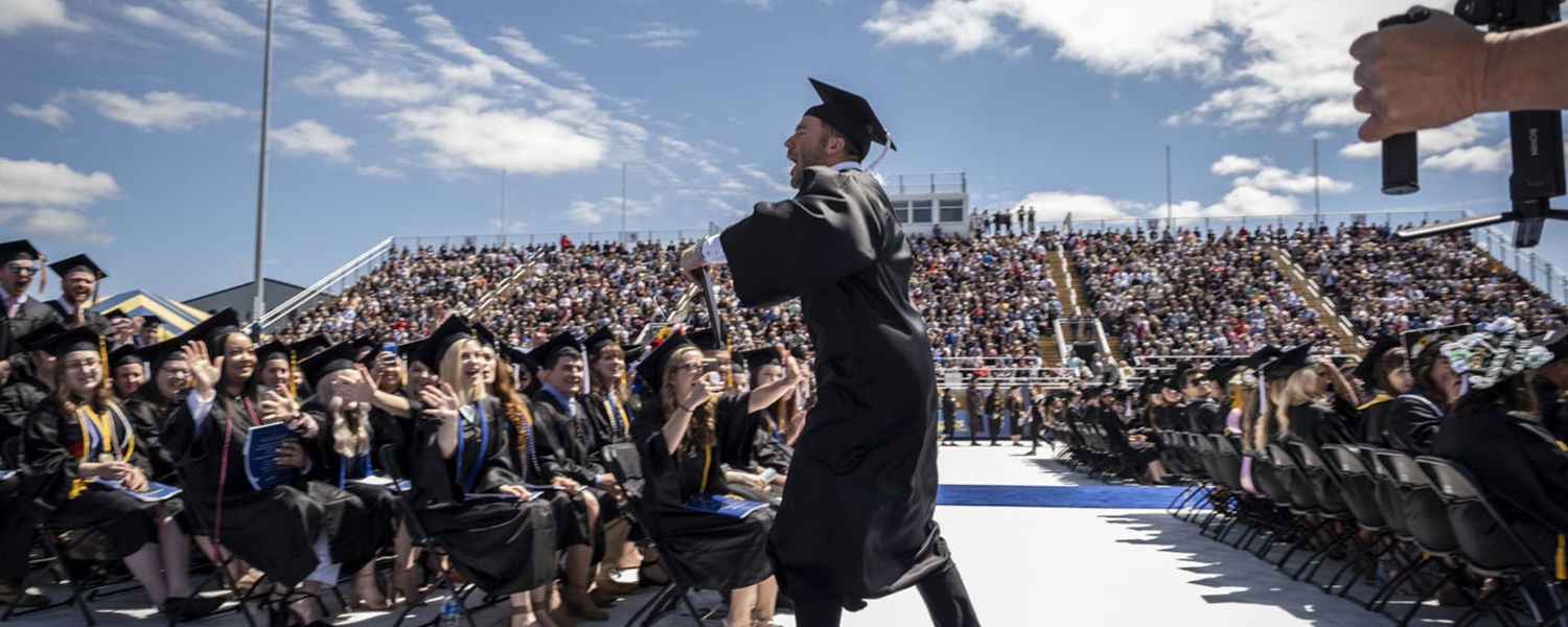 New Kent State graduate Julian Edelman celebrates after receiving his degree at the One University Commencement held at Dix Stadium.