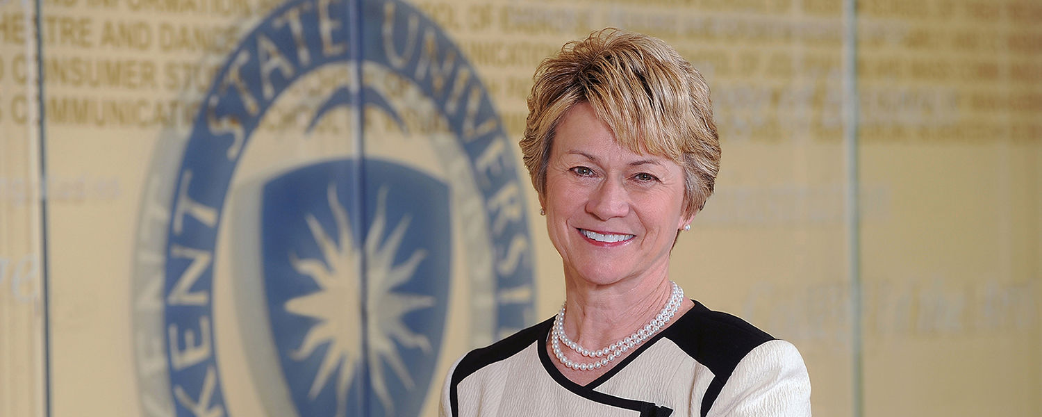 Beverly Warren, Kent State's 12th president, stands outside the executive offices in the University Library.