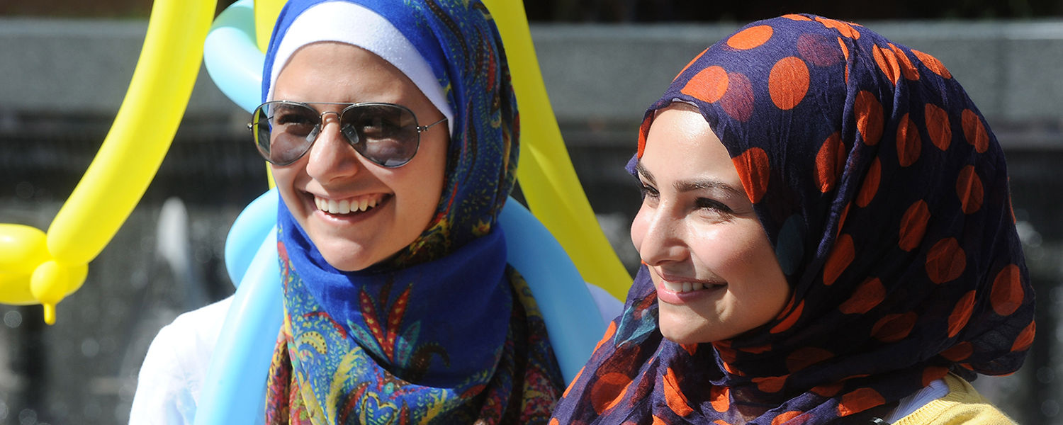 Two members of the Muslim Students Association enjoy the sunny day on Risman Plaza while participating in the 32nd Annual Black Squirrel Festival.