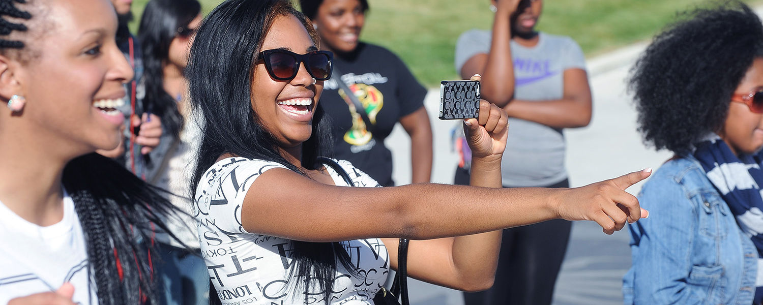 Kent State students enjoy the musical entertainment on the Student Green during the 32nd Annual Black Squirrel Festival.