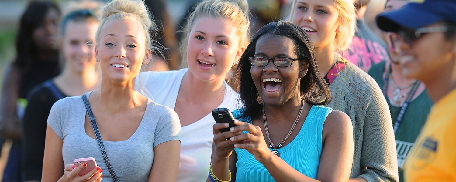 Kent State students share a laugh while participating in the festivities on the Student  Green during the back-to-school Blastoff.
