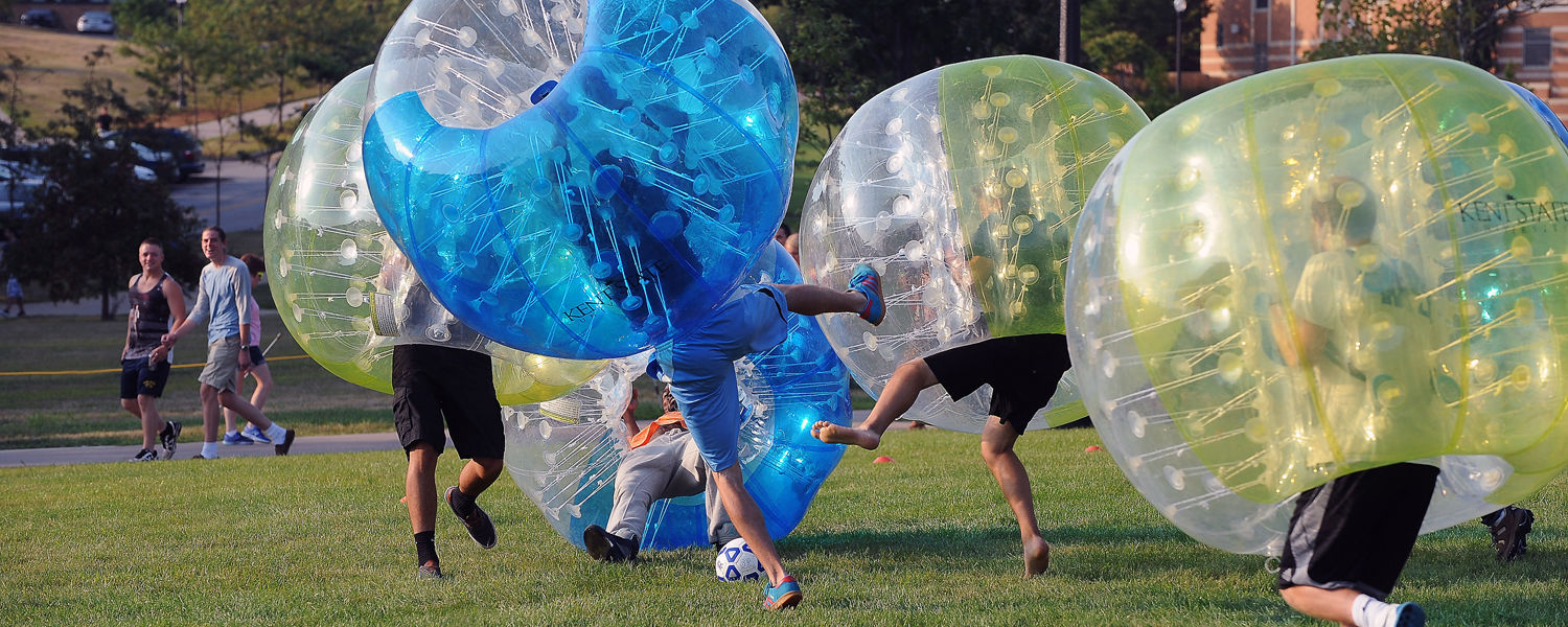 Kent State students participate in the Intramural Department's bubble soccer competition set up on Manchester Field during the 2015 Blastoff event.