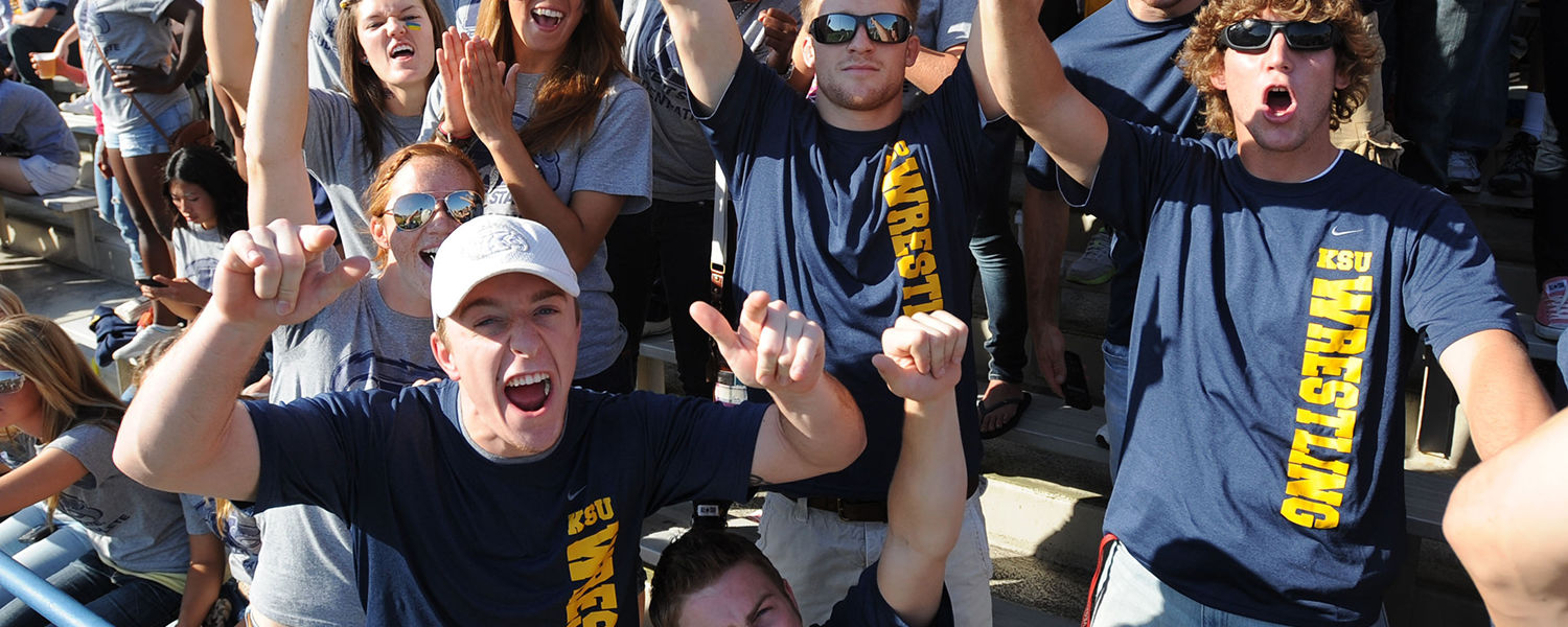 Kent State students wear their blue and gold while cheering on the football team during a home football game at Dix Stadium.