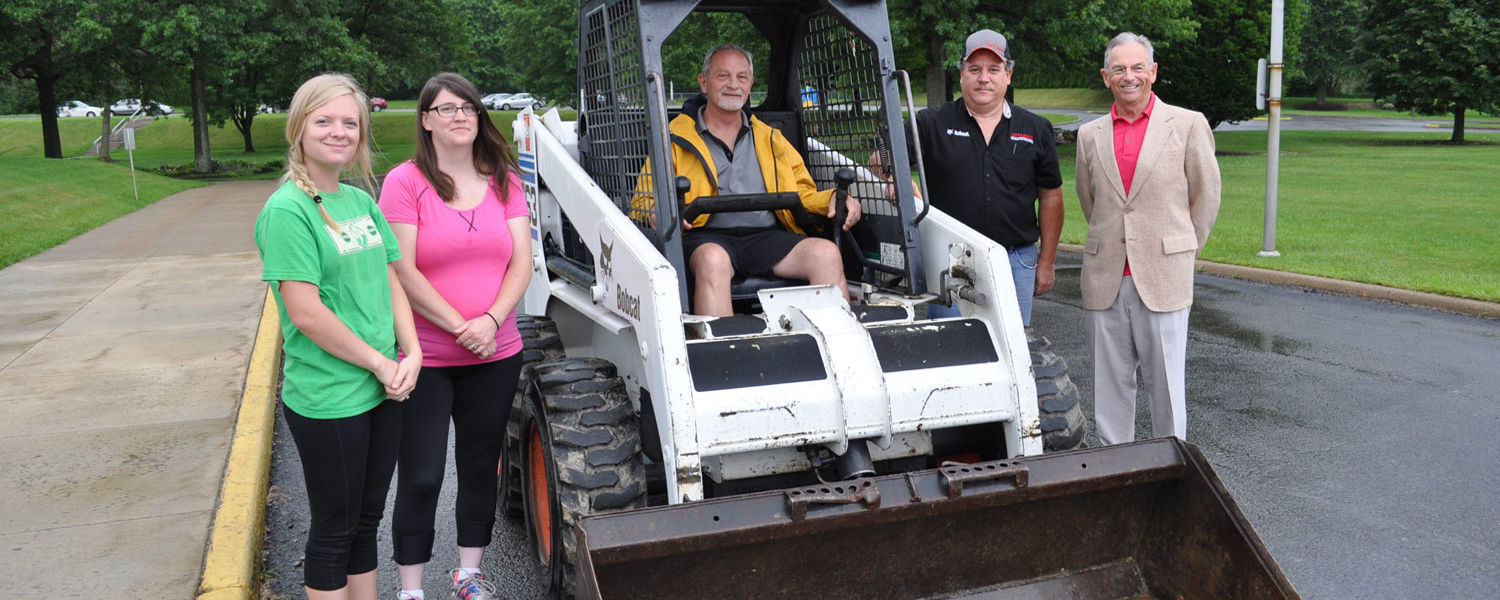 With the donated Bobcat are (from left) horticulture students Claire Smith and Samantha Keshock; John Majernik, program director for the horticulture program at Kent State Salem; Butch Bisirri, sales specialist at Leppo Rents; and Dr. Steve Nameth, dean a