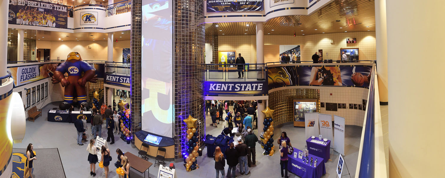 The lobby of the MAC Center is decorated with Kent State colors, new wall graphics and a vertical video screen showing members of the men's and women's basketball teams.