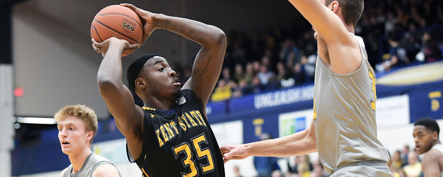 Kent State forward Jimmy Hall powers through Toledo Rocket defenders for two points during the Golden Flashes 85-61 win in the MAC Center.