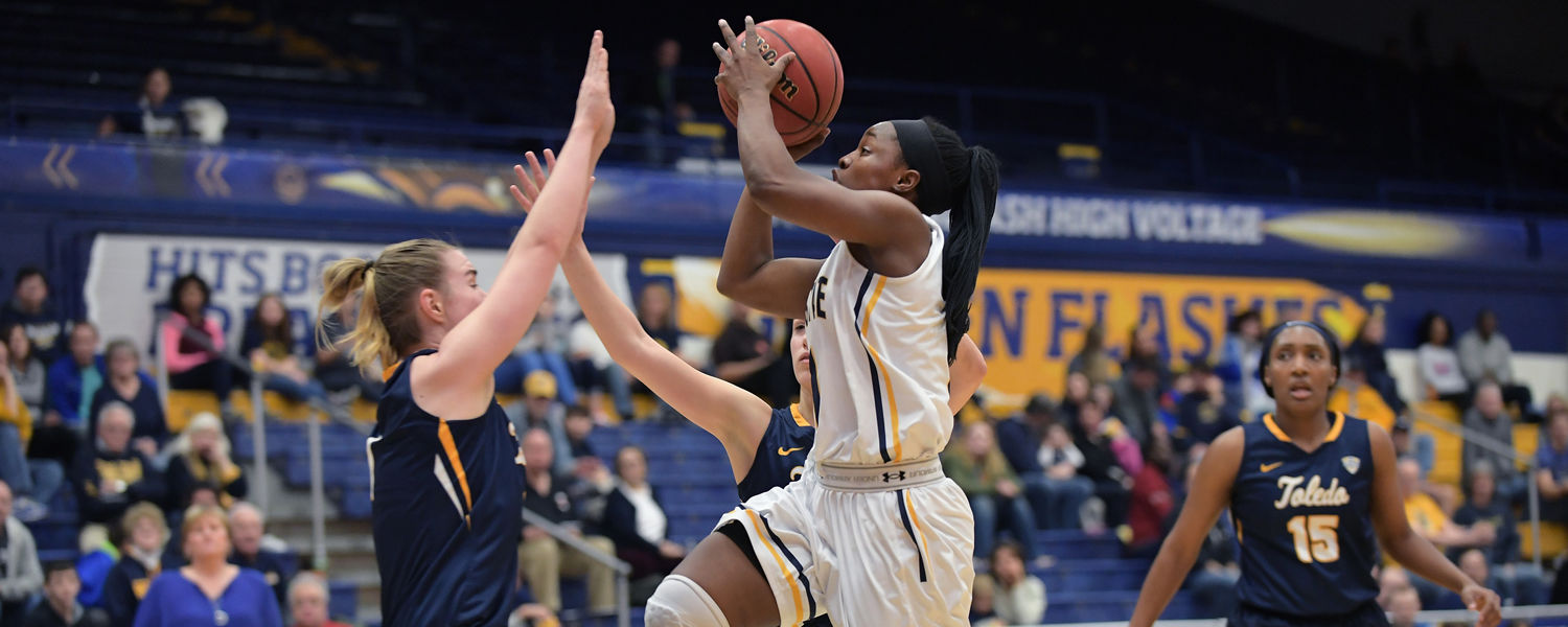 Kent State's Naddiyah Cross scores on a hard drive to the basket during the team's 70-60 win over the Toledo Rockets in the MAC Center.