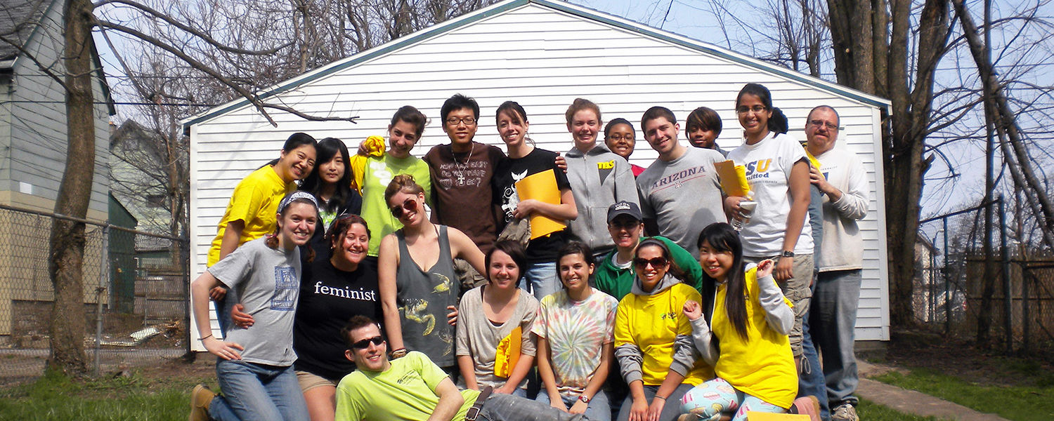Kent State students gather in Buffalo outside of a Habitat for Humanity house rebuild in Buffalo, N.Y.