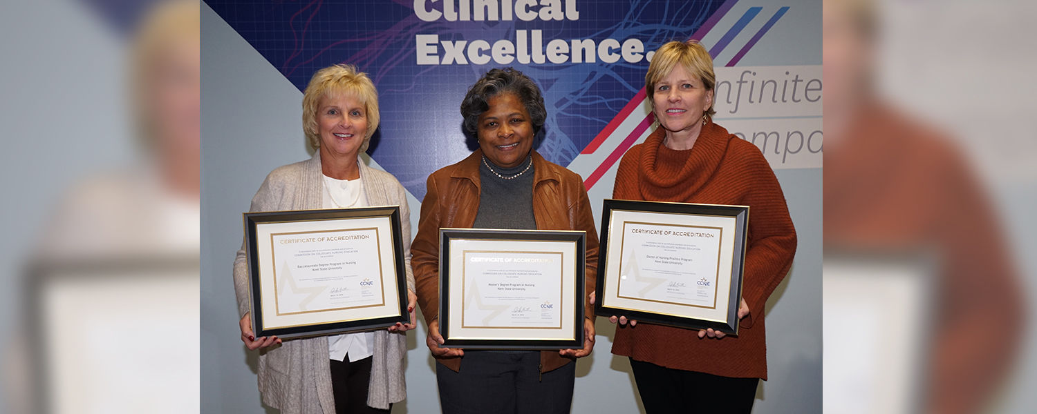 (From left) Tracey Motter, DNP, RN, associate dean for undergraduate programs, Dean Barbara Broome, Ph.D., RN, FAAN, and Wendy Umberger, Ph.D., RN, PMHCNS-BC, associate dean for graduate studies, hold the CCNE accreditation certificates.