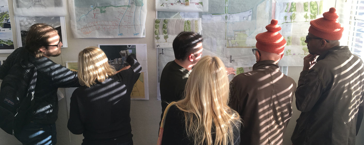 Community members from Erie, Pennsylvania, gather with students from Kent State University's Cleveland Urban Design Collaborative to see the progress being made with designs for the bayfront.