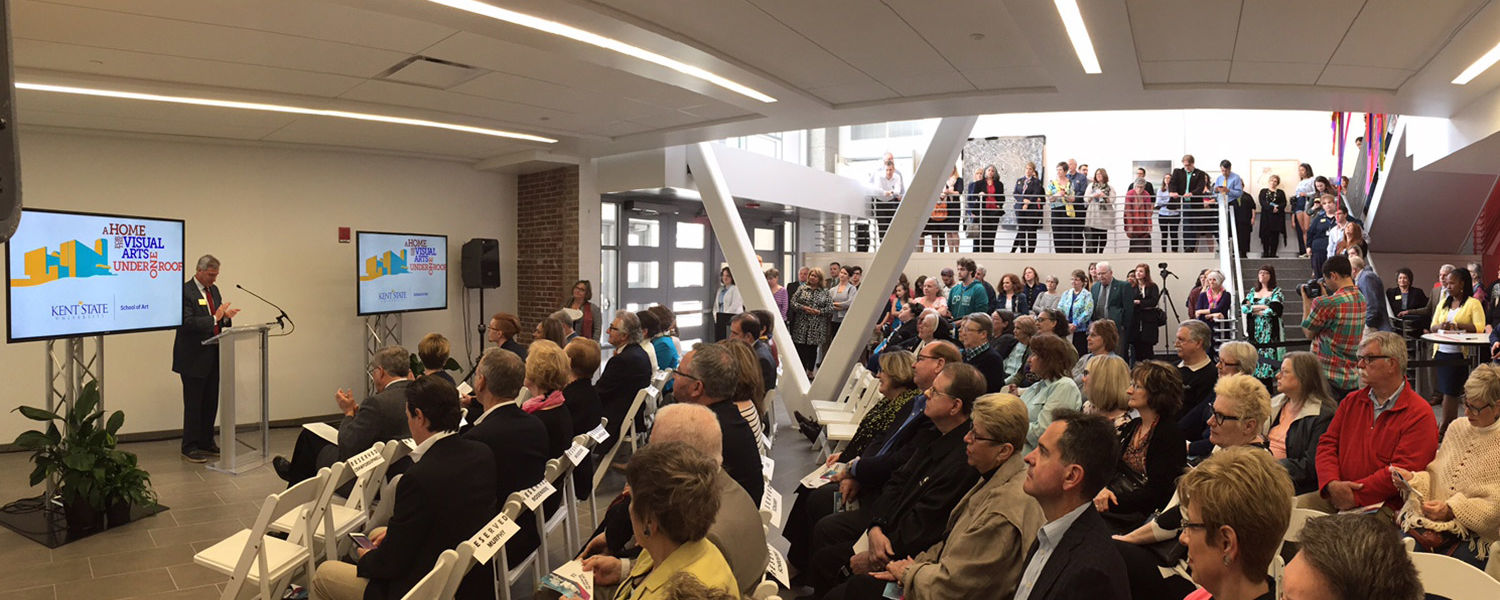 John Crawford-Spinelli, dean of Kent State's College of the Arts, addresses a large gathering of Kent State students, employees, alumni and donors during the grand opening celebration of the new Center for the Visual Arts.
