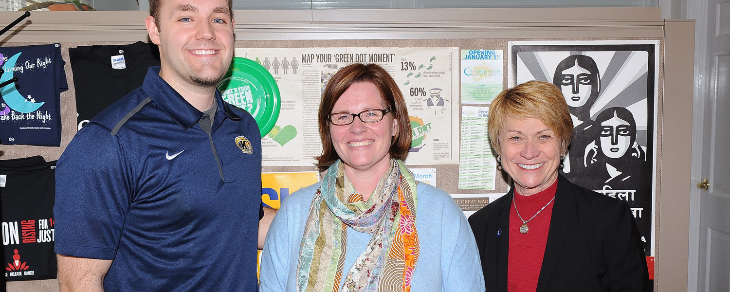 Cassandra Pegg-Kirby (center), winner of a President's Excellence Award, stands with Kent State President Beverly Warren (right) and co-worker Carmen Roberts (left) after receiving her award.