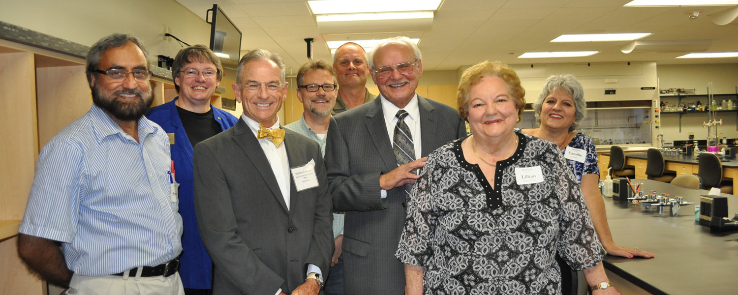 Members of the Centofanti family gather with biology and chemistry professors in the new chemistry lab on the completed second floor of Centofanti Hall.