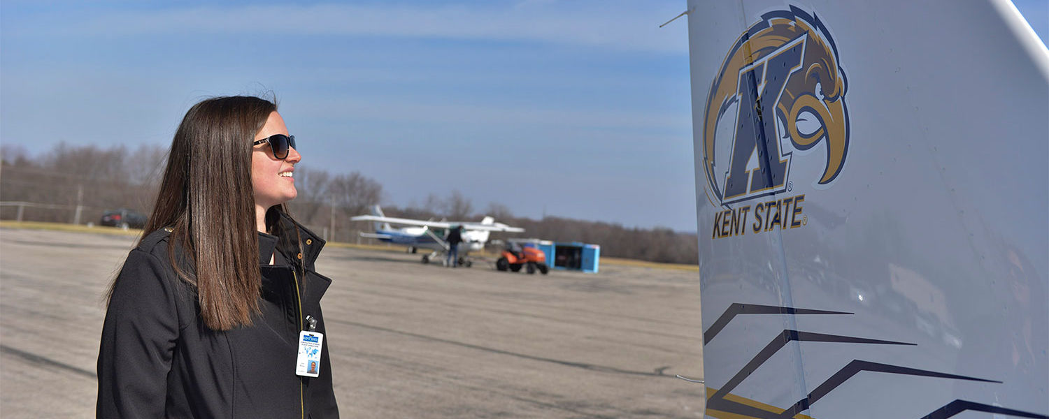 A Kent State aeronautics student looks over a Cessna 172 that she will fly in the 2016 Air Race Classic.