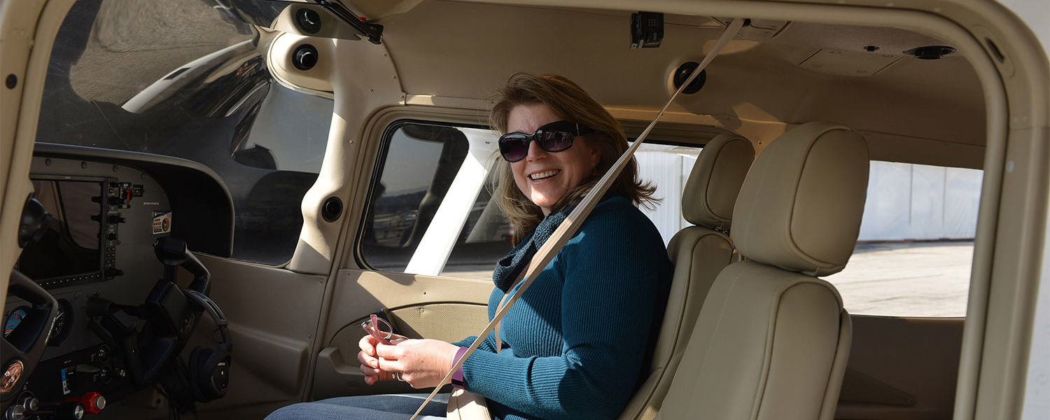 Deb Anstine sits in the cockpit of a brand new Cessna Skyhawk 172 named Nikki in honor of her stepdaughter, Nikki Kukwa.