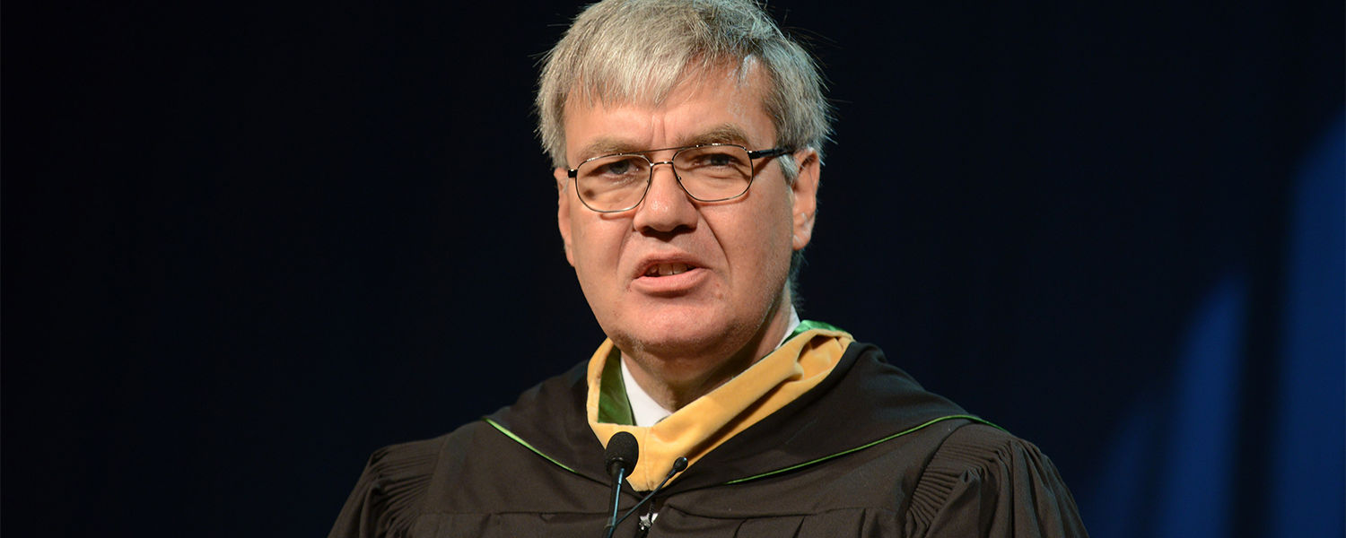 Ohio Department of Higher Education Chancellor John Carey speaks at Kent State's Summer 2013 Commencement ceremony in the Memorial Athletic and Convocation Center.
