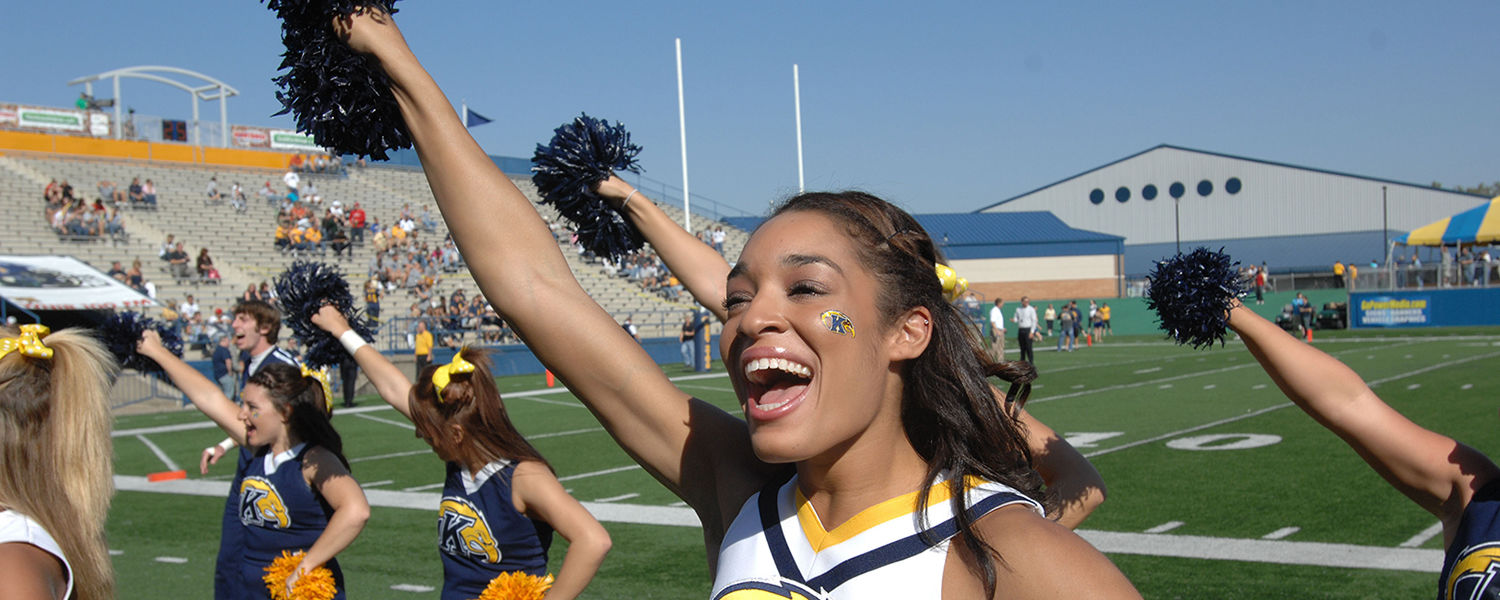 The Kent State cheerleaders fire up the crowd during the 2012-13 football season.