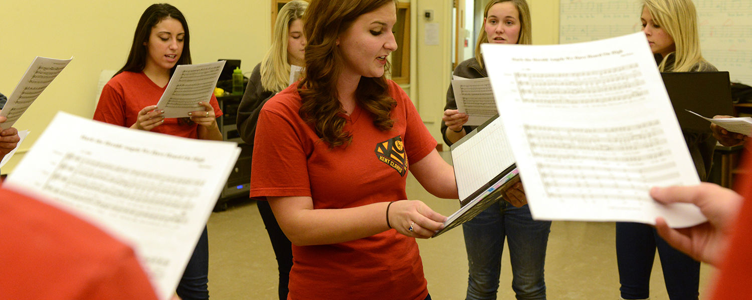 Kent State senior theatre studies major Meagan Eishen (center) leads members of the Kent Clarks in a practice session. The a capella singing group recently performed at the White House.