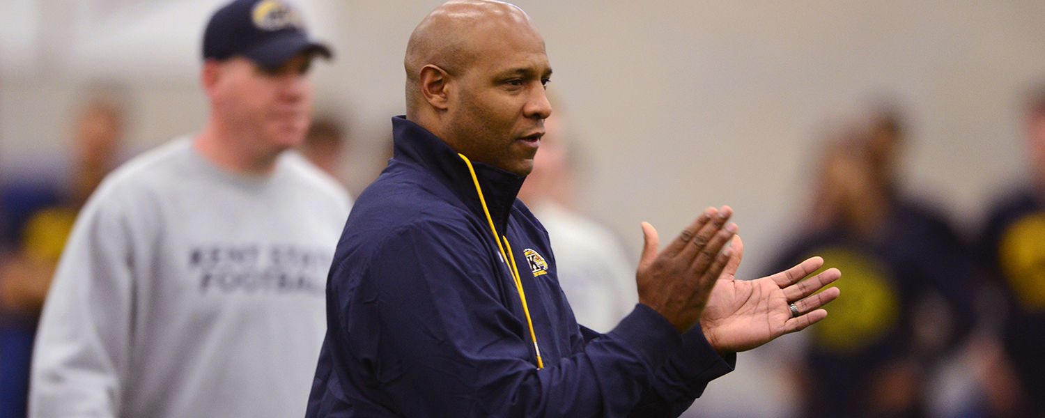 Kent State head football coach Paul Haynes works with his players during an early-morning workout in the Kent State Field House.