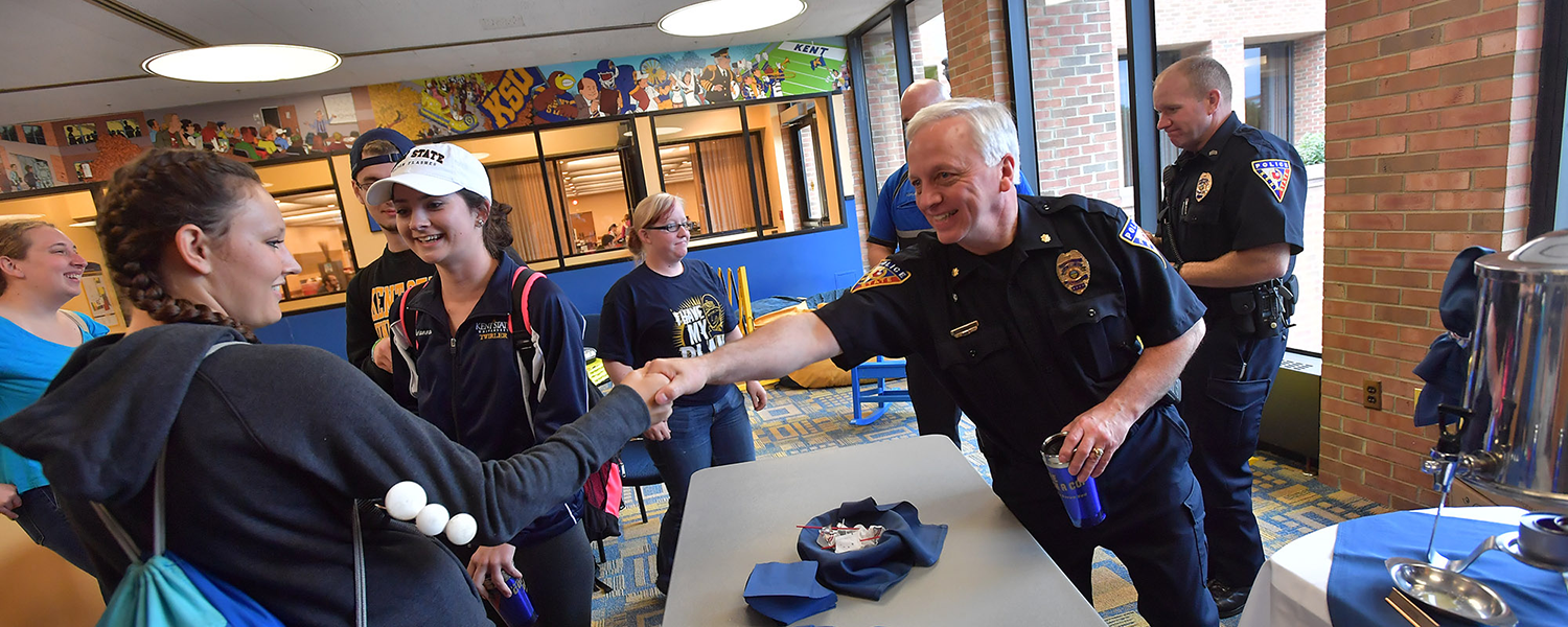 Kent State Police Officers welcome students to a recent event.