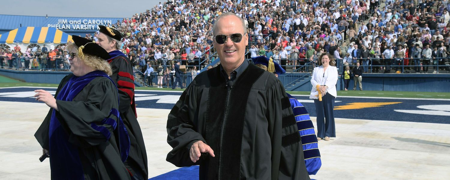 Oscar-nominated actor and commencement speaker Michael Keaton enters Dix Stadium to the cheers of graduating students and families during Kent State's 2018 One University Commencement.