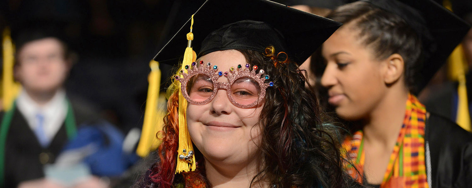 A Kent State graduate celebrates the season during the Fall Commencement ceremony.