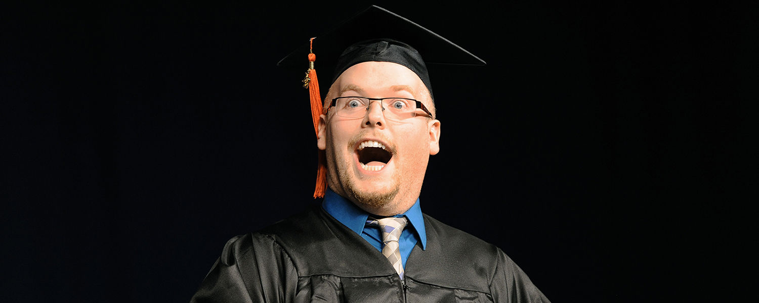 A Kent State graduate reacts after receiving his diploma during morning commencement ceremonies in the Memorial Athletic and Convocation Center.