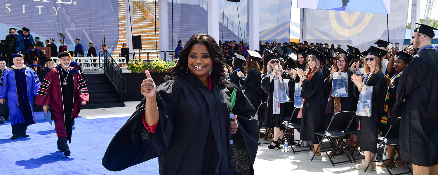 Commencement speaker Octavia Spencer gives a thumbs-up to the Kent State students who cheer for her following her address during the One University Commencement Ceremony.