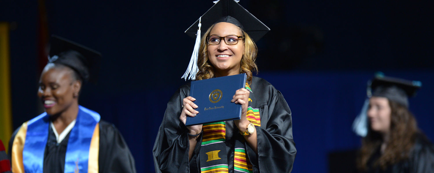 A new Kent State graduate is all smiles after receiving her diploma during a Spring 2016 Commencement ceremony in the MAC Center.