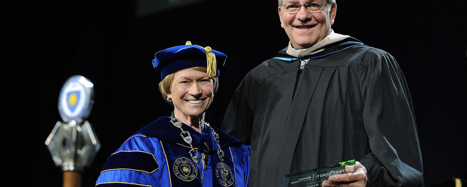 Kent State President Beverly Warren recognizes Kent State alumnus Donald C. Brown, executive vice president and chief financial officer of FedEx Freight Corporation, during the Summer 2016 Commencement ceremony.