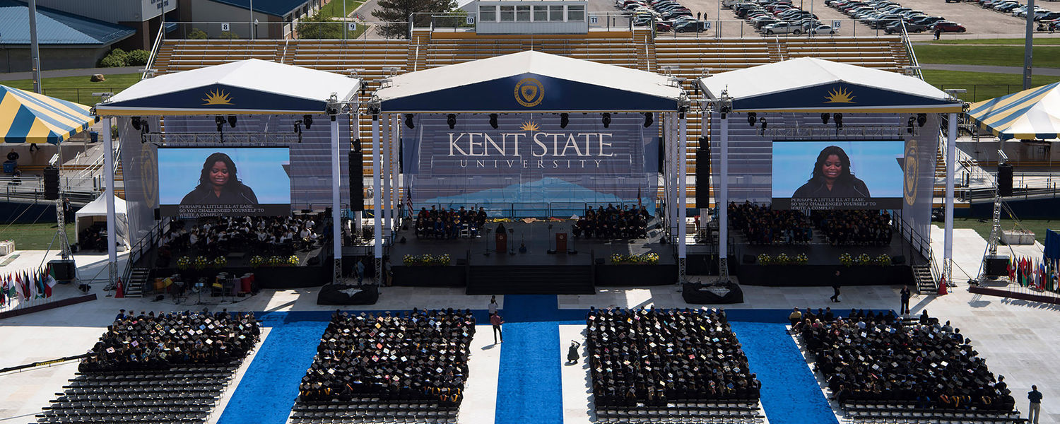Kent State students fill the seats on the field at Dix Stadium for the One University Commencement Ceremony.