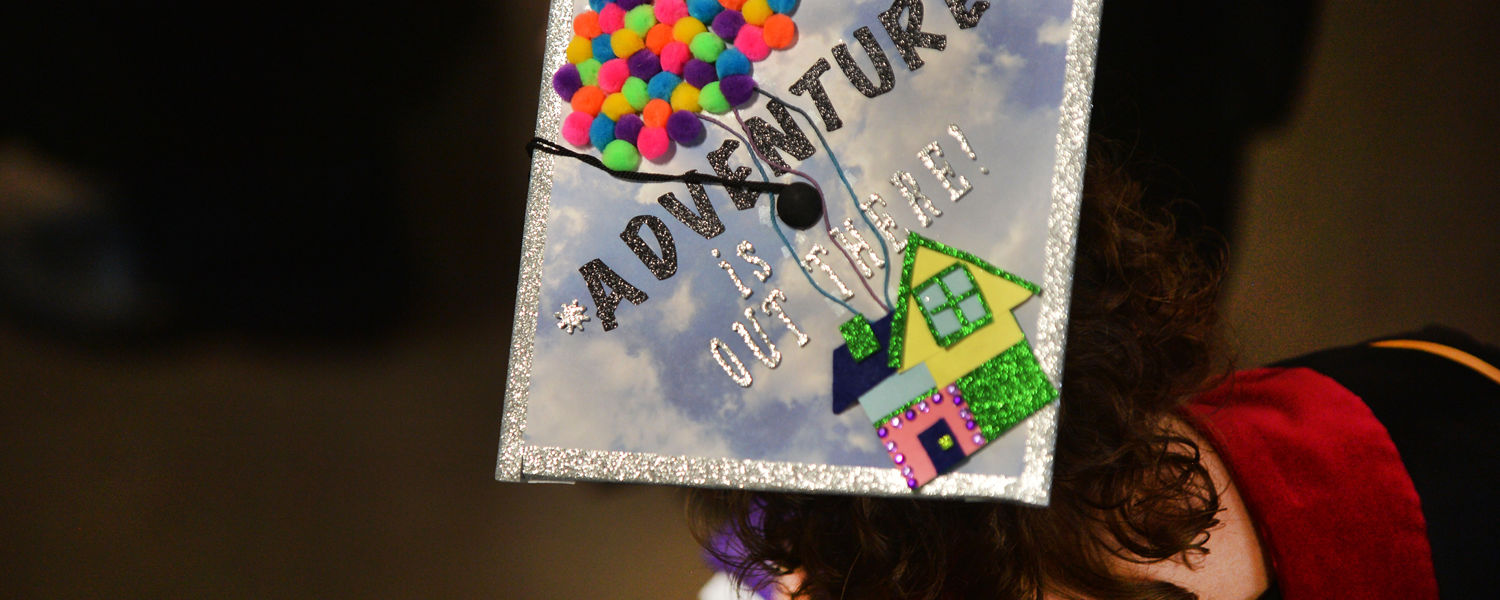 A Kent State student displays a creative mortar board while waiting for her Commencement ceremony to begin.
