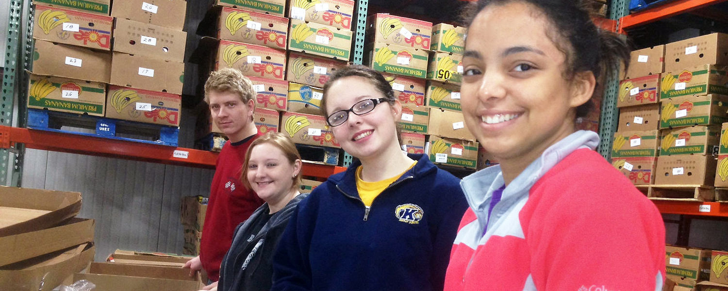 Kent State students sort and bag thousands of pounds of cereal at the Second Harvest Food Bank of the Mahoning Valley.