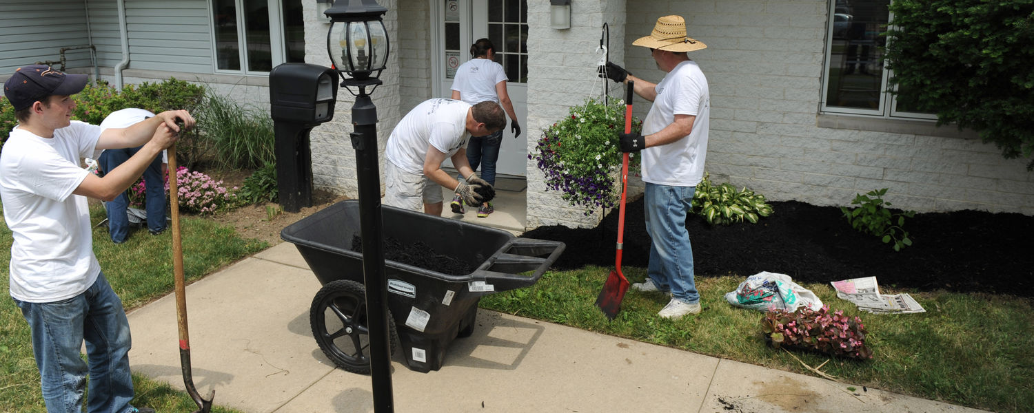 Volunteers from Kent State spread mulch, pull weeds and clean up the grounds of the Freedom House. The Freedom House is a transitional home for homeless veterans.