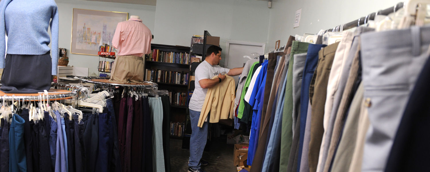 A Kent State student sorts donated clothing at a free clothing store in Ravenna.